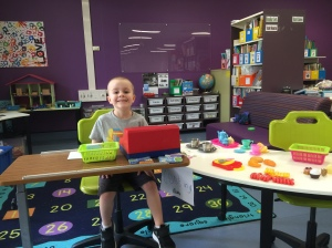Liam playing shop in the class room